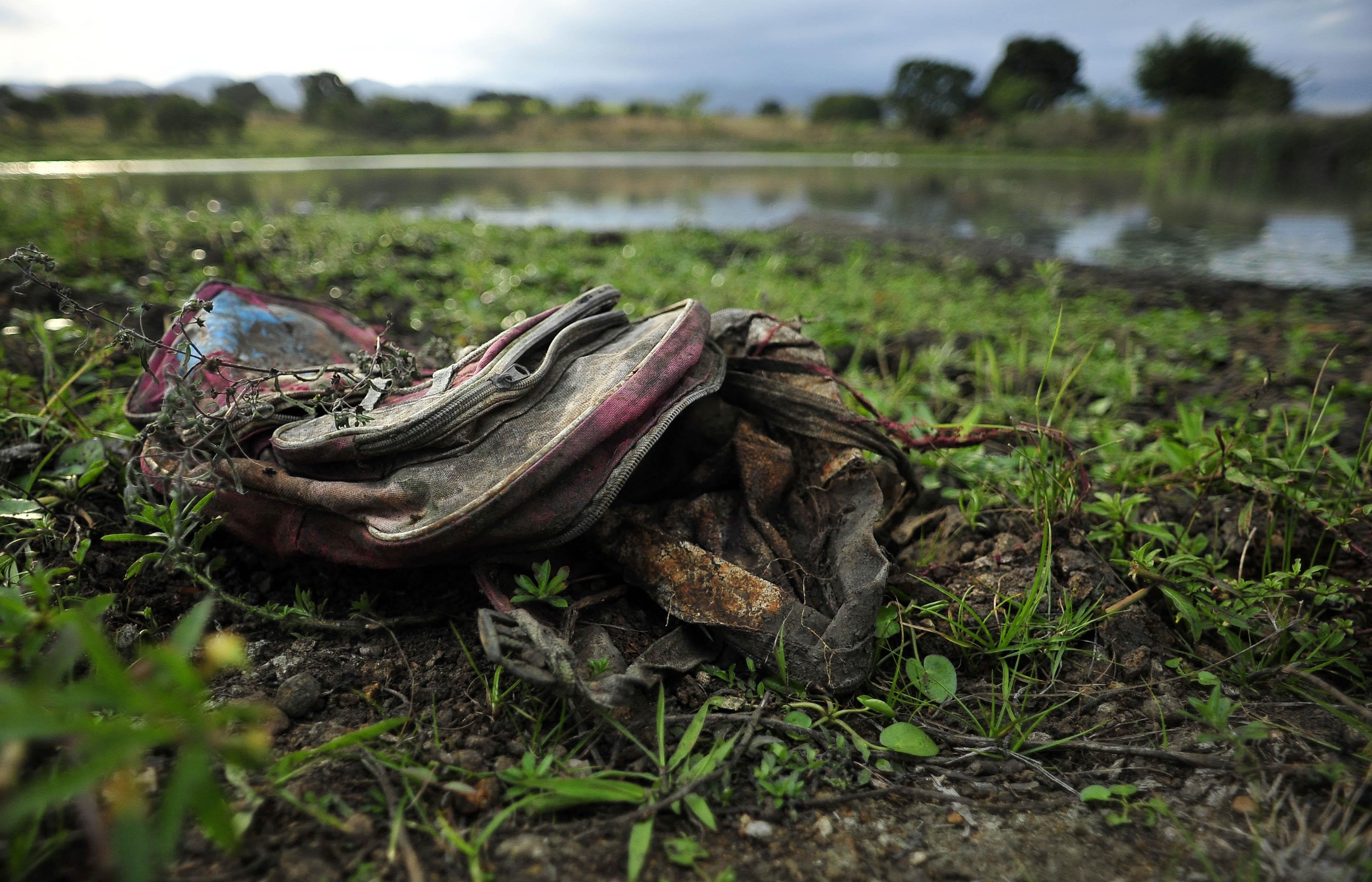 Cuerpos hallados en fosas pueden ser de migrantes: Figueroa