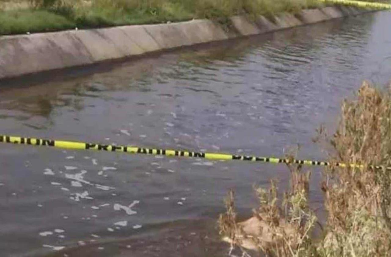Encuentran cuerpo flotando en canal de aguas negras, en Fortín