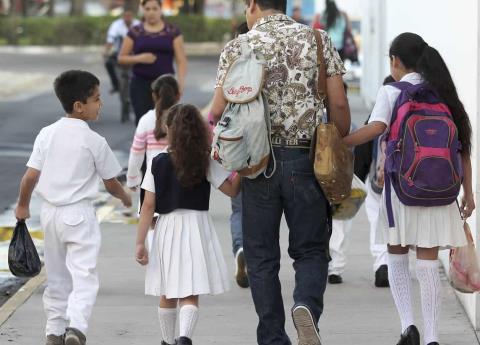 ¿Publicar o no fotos de los niños en su regreso a clases?