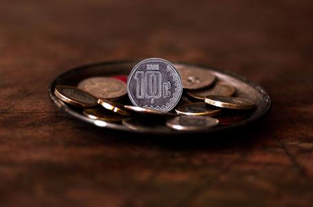Cada moneda de 10 centavos, cuesta 14.5 centavos