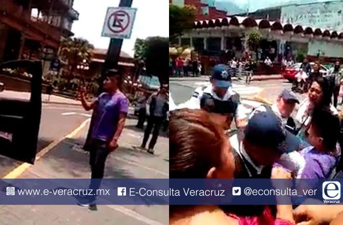 Detienen a menor que grabó a policías quitando mercancía a vendedora