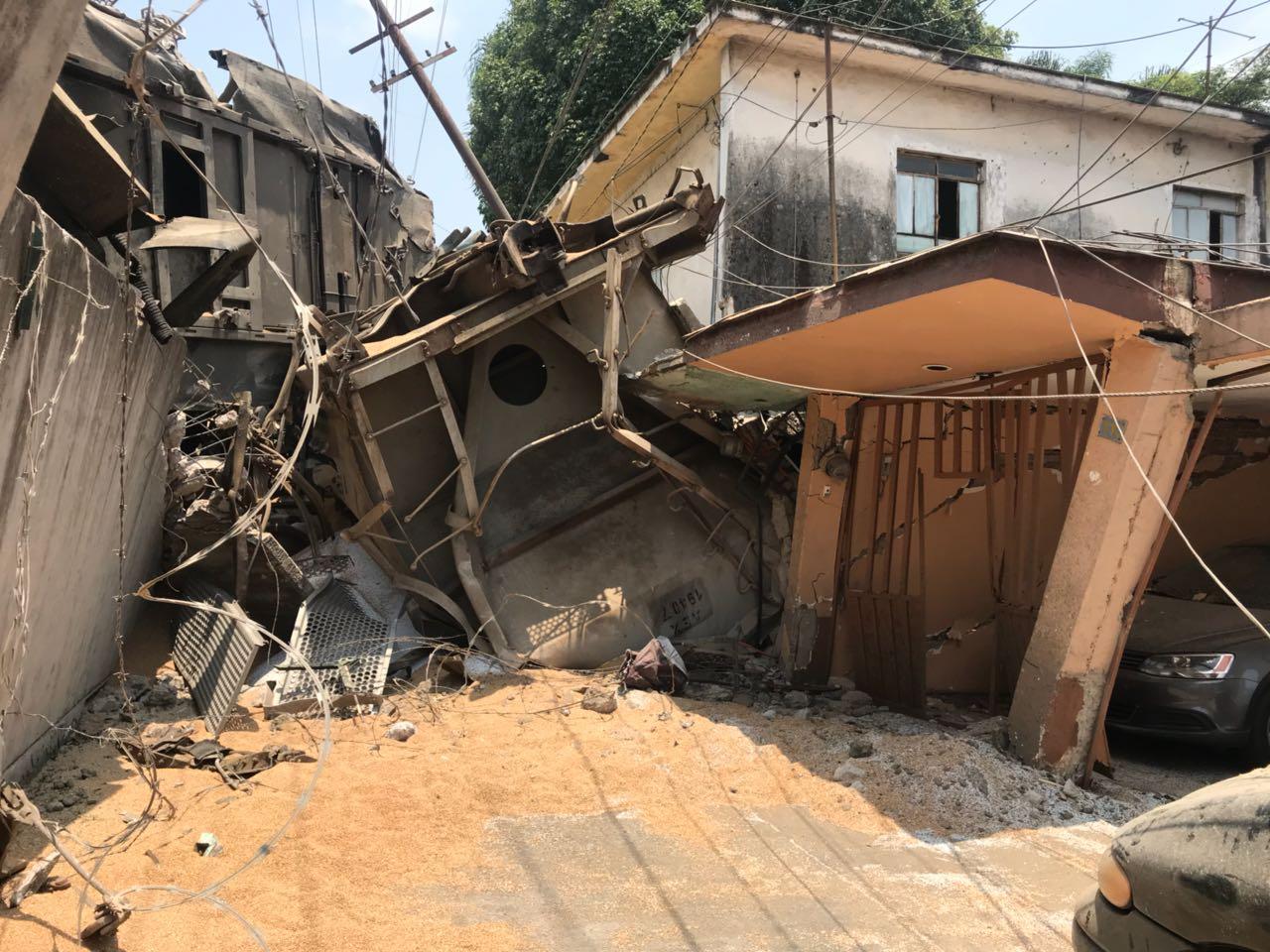 Fotos: los daños a viviendas que provocó choque de trenes en Río Blanco